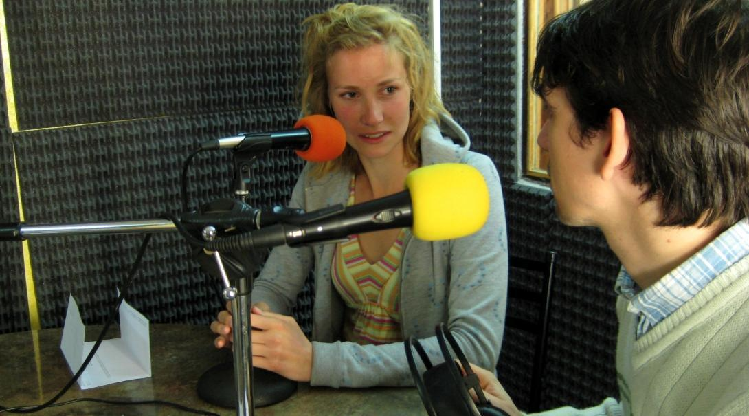 Two Projects Abroad interns practice interviewing each other at a radio station as part of their Journalism internship in Argentina.